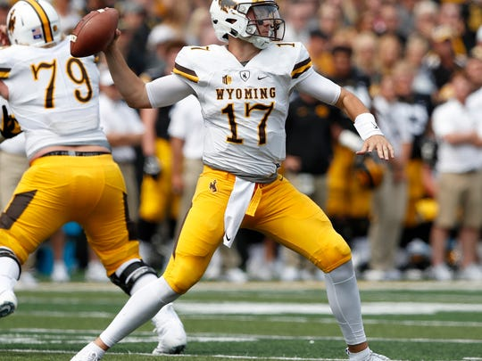 FILE - In this Sept. 2, 2017, file photo, Wyoming quarterback Josh Allen throws a pass during the second half of an NCAA college football game against Iowa in Iowa City, Iowa. Allen had a long day against Iowa and it got even worse against Oregon. The Wyoming quarterback's two big chances to show off his prodigious talents were pretty much a flop, but make no mistake: Allen is still one of the most talented college quarterbacks in the country and a potential high draft pick. (AP Photo/Charlie Neibergall, File)