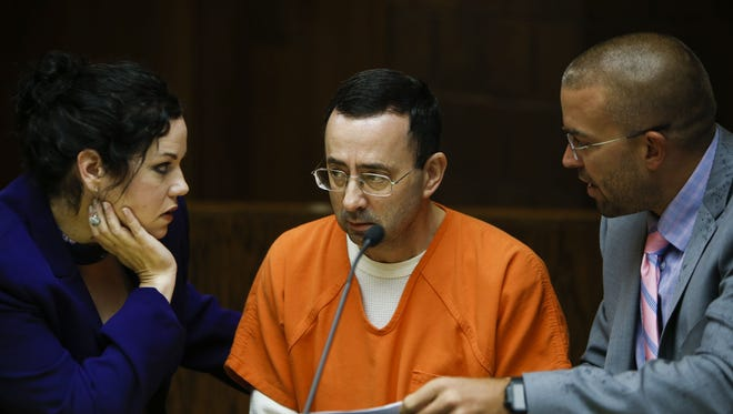 Larry Nassar is flanked by his attorneys Shannon Smith, left, and Matt Newburg Friday morning, June 23, 2017, in District Judge Donald Allen's 55th District Court room.  Today is expected to be the final day of his preliminary hearing on multiple sexual assault charges.  [MATTHEW DAE SMITH/Lansing State Journal]