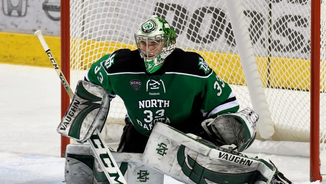 This Jan. 16, 2016 photo provided by the University of North Dakota shows UND goalie Cam Johnson during an NCAA hockey game in Grand Forks, N.D.