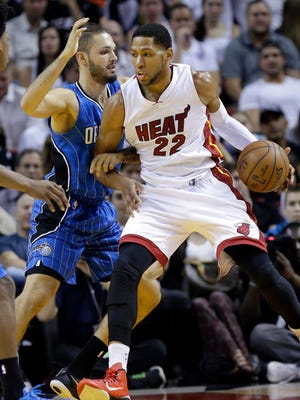 Miami Heat forward Danny Granger (22) is defended by Orlando Magic guard Evan Fournier, left, during the first half of an NBA basketball game, Monday, Dec. 29, 2014, in Miami.
