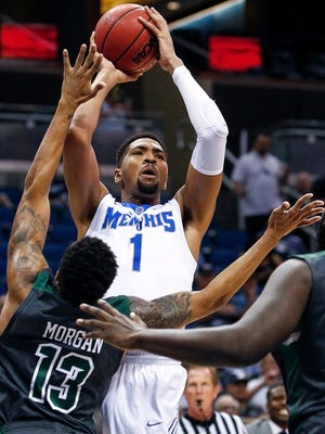 March 12, 2016 -  University of Memphis forward Dedric Lawson (top) puts up a shot over Tulane University defender Malik Morgan (left) during first half action in their AAC tournament semifinals game at the Amway Center in Orlando, Florida.
