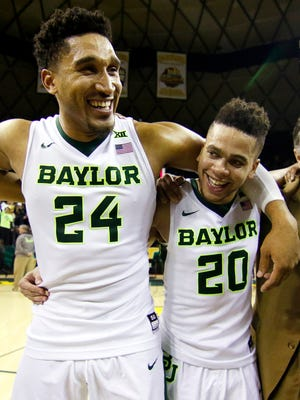 Baylor guard Ishmail Wainright (24) and guard Manu Lecomte (20) following the Bears 61-57 victory over the Oklahoma State Cowboys at Ferrell Center.