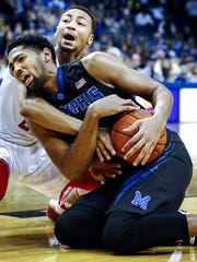 University of Memphis forward Dedric Lawson (front) battles University of Houston defender Galen Robinson Jr. (back) during second half action at the FedExForum.