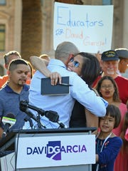 Arizona Democrat David Garcia receives a hug from his
