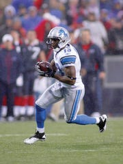 Nate Burleson (No. 13) of the Detroit Lions runs against the Buffalo Bills at Ralph Wilson Stadium on November 14, 2010 in Orchard Park, New York. The Bills won 14-12.
