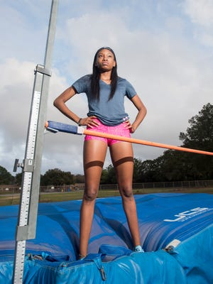 Tytavia Hardy poses on the high jump at Booker T. Washington High School in Pensacola on Wednesday, February 28, 2018.