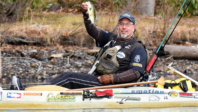 Layne Ell, president of the South Jersey Kayak Bass Fishing Club, enjoys the warm weather while flipping some jigs for bass on Hammonton Lake. Wednesday, March 11, 2015