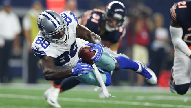 Dallas Cowboys receiver Dez Bryant (88) dives for the end zone for a touchdown in the fourth quarter against the Chicago Bears at AT&T Stadium.