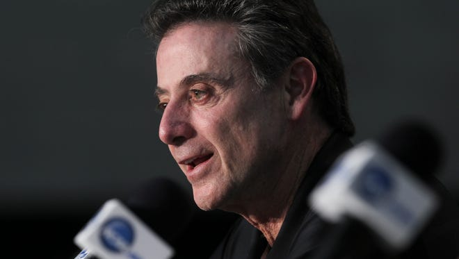 U of L head coach Rick Pitino talks about their upcoming NCAA game against St. Louis at the Amway Center in Orlando, Fl. Mar. 21, 2014