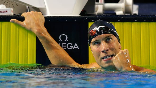 Matt Grevers of Tucson set a world record in the 100-meter  short course backstroke at the Duel in the Pool in Indianapolis.