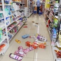 Shampoos, detergents, Japanese rice wine packs and other items are scattered on the floor at a convenience store after a strong earthquake in Nagano, Japan.