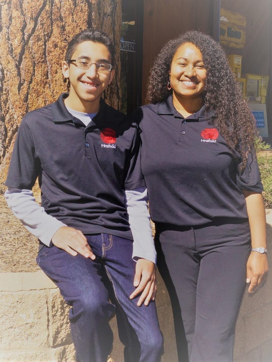 Zion and Brenna Chee, owners of Hnzhúú Cleaning Services.