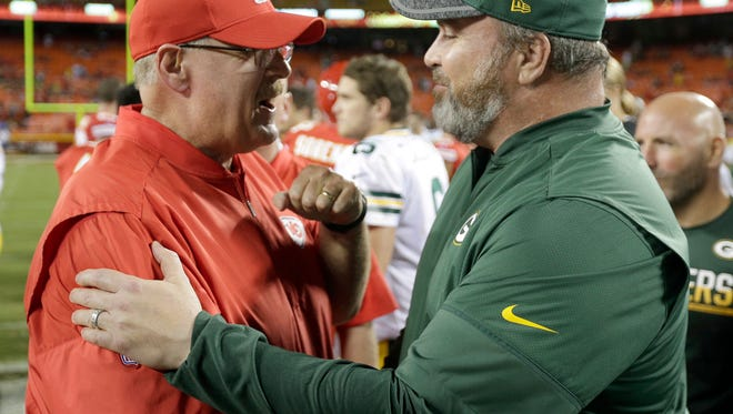 Kansas City Chiefs coach Andy Reid, left, and Green Bay Packers coach Mike McCarthy meet following an NFL preseason football game in Kansas City, Mo., Thursday, Sept. 1, 2016. The Chiefs won 17-7.
