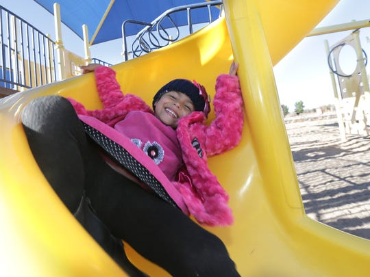 Ariel Morales, 4, plays Tuesday at Gallegos Park in Canutillo. Ariel's mother, Jamie, quit her job after Ariel became ill and now the family needs a bit of help this holiday season.