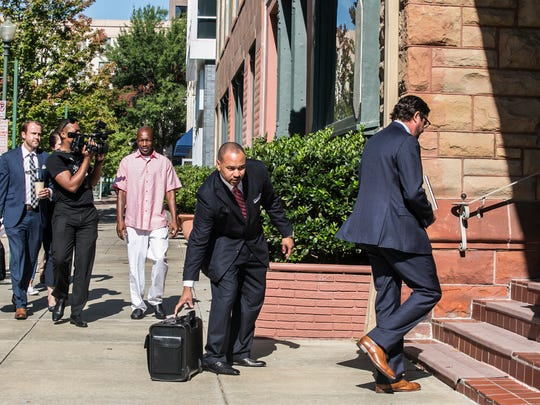 September 14, 2017 - Henry Williams (left), the father of the late Darrius Stewart, enters Burch Porter & Johnson with his attorneys Carlos Moore, center, and Murray Wells for a deposition with former Memphis police officer Connor Schilling on Thursday. Schilling shot and killed 19-year-old Stewart following a traffic stop in Hickory Hill on July 17, 2015.