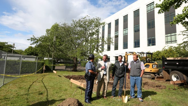 Oregon State Police Lt. Cari Boyd, Salem City Councilman Brad Nanke, Dan Wellert of White Oak Construction and Architect Gene Bolante of Studio 3 Architecture speak during a ground breaking ceremony at the site of an Oregon State Police Fallen Trooper Memorial on Tuesday, June 14, 2016, in front of the Public Safety Building at the Capitol Mall in Salem.