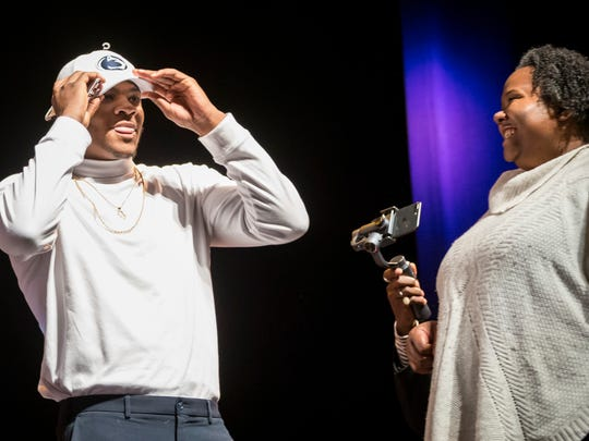 Harrisburg High School defensive end Micah Parsons dons a Penn State hat announcing his intentions to attend the school during the NCAA college football early signing period, Wednesday, Dec. 20, 2017, in Harrisburg, Pa. (Joe Hermitt/PennLive.com via AP)