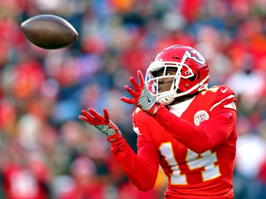 Jan 19, 2020; Kansas City, Missouri, USA; Kansas City Chiefs wide receiver Sammy Watkins (14) catches a touchdown during the second half against the Tennessee Titans in the AFC Championship Game at Arrowhead Stadium. Mandatory Credit: Mark J. Rebilas-USA TODAY Sports