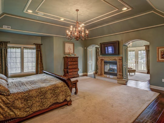 The master bedroom at 2 Embry Farm Road has a fireplace.