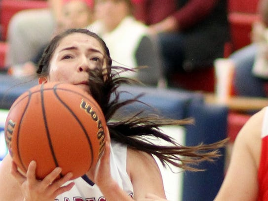 Brooke Huerta (24) looks for an opening lane to the