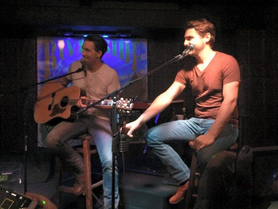 Jake Owen (left) performs with Kurt Stevens in 2014