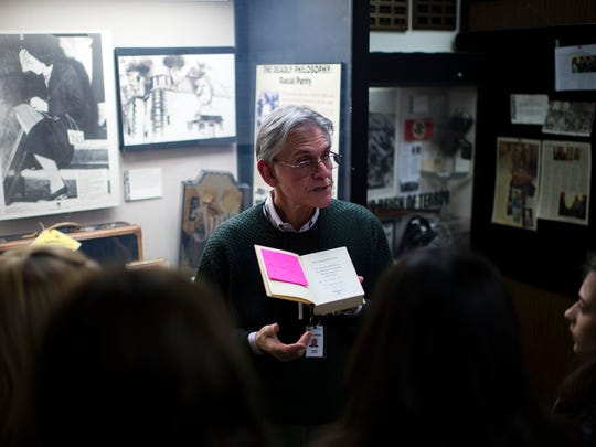 Museum docent Jeff Green displays a copy of Adolf Hitler's 'Mein Kampf' inside the Esther Raab Holocaust Museum in Cherry Hill.