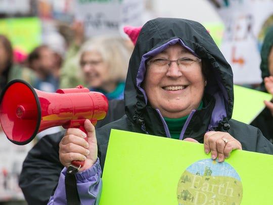 Maggie Miller, of Ocean Pines, leads a group of people