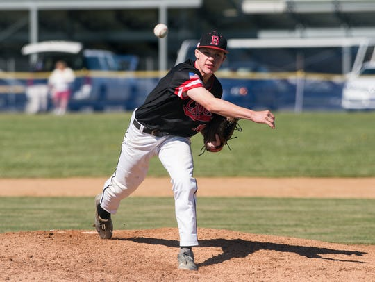 James M. Bennett's pitcher throws the ball during a