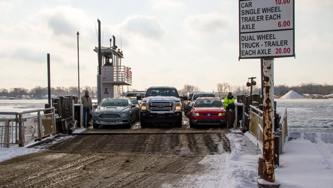 Vehicles unload off of Champion Auto Ferry in Clay Township Dec. 29. Effective Jan. 1, rates to travel between Algonac and Harsens Island on the ferry will increase.