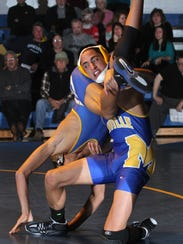 Manville's Kevin Murillo, right, wins this 132 pound