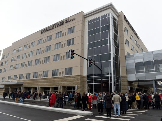 Local residents file into the new 241-room, five-floor Hilton DoubleTree hotel after its official opening in Downtown EvansvilleÊTuesday, Feb., 14, 2017.