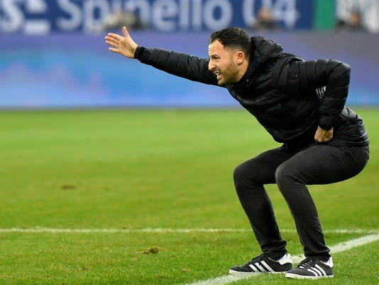 FILE - In this Dec. 19, 2017 file photo Schalke's head coach Domenico Tedesco reacts during the German soccer cup match between FC Schalke 04 and FC Cologne in Gelsenkirchen, Germany. With eight games of the season remaining, Tedesco's side is best-placed for a return to the Champions League along with soon-to-be-crowned champion Bayern Munich.  (AP Photo/Martin Meissner, file)