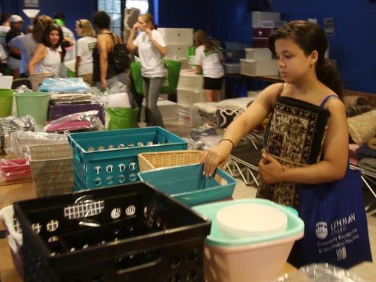 Bethany Rondon of Yonkers, looks for supplies for her