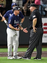 Vanderbilt head coach Tim Corbin argues an interference