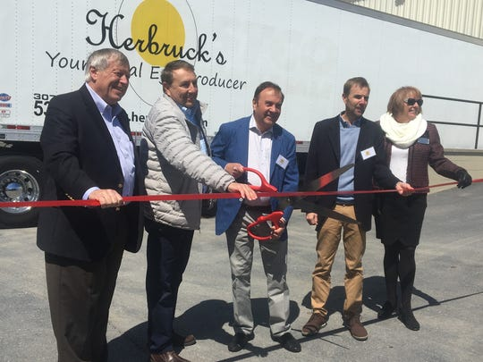 Steve Herbruck prepares to cut the ribbon for the Herbruck's cold storage warehouse in Franklin County, Pennsylvania. With him are (from left) James Byrum, Greg Herbruck, Steve, Herb Herbruck and Rose Plummer.