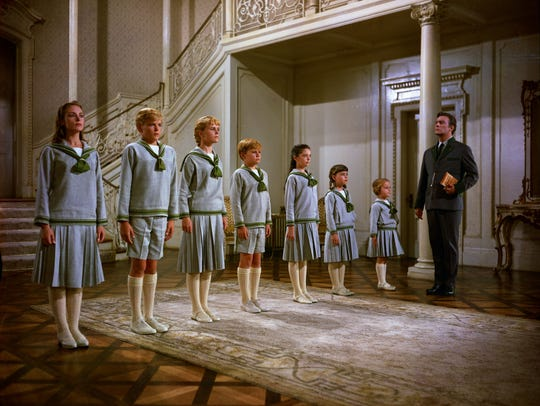Captain Von Trapp (Christopher Plummer) keeps his children