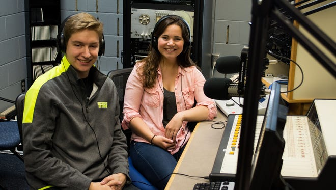 Connor Madison and Sherry McMahon pose in the WRST-FM studio, a radio station at UW-Oshkosh. The two started kindergarten together 17 years ago and graduated from UW-Oshkosh together last Saturday.