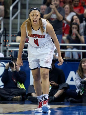Louisville's Antonita Slaughter and the crowd are excited after she knocked down a shot against Maryland.  April 1, 2014