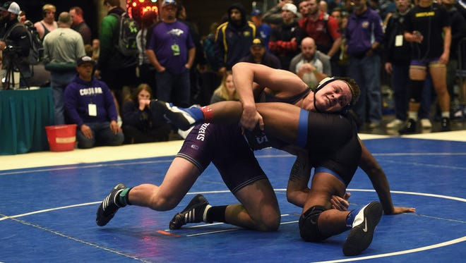 Spanish Springs' Colby Preston, top, defeats Xavier Whitson in a 195-pound consolation match at the Reno Tournament of Champions wrestling event last week.