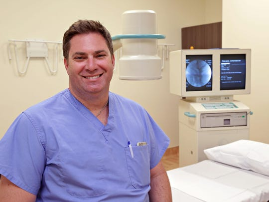 Dr. Daniel Lieberman, MD, in his new new Phoenix Spine Surgery Center, in front of an open Xray machine and processor as seen in Goodyear on June 2, 2015.