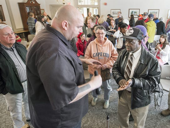 Braddock Mayor John Fetterman talks with John Jamison,