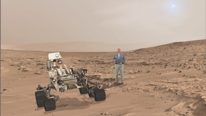 In a provided press kit photo, a holograph of Buzz Aldrin is on Mars in ascene for the new attraction.