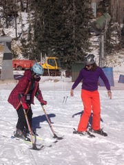 Mona Patel skiing with Ski Apache Adaptive Sports director