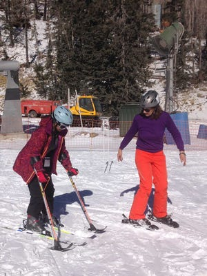 Mona Patel skiing with Ski Apache Adaptive Sports director Shippen Davis-Salas.