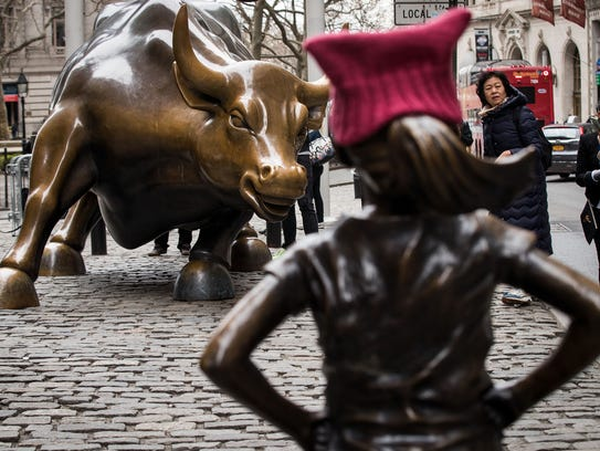 'The Fearless Girl' statues stands across from the