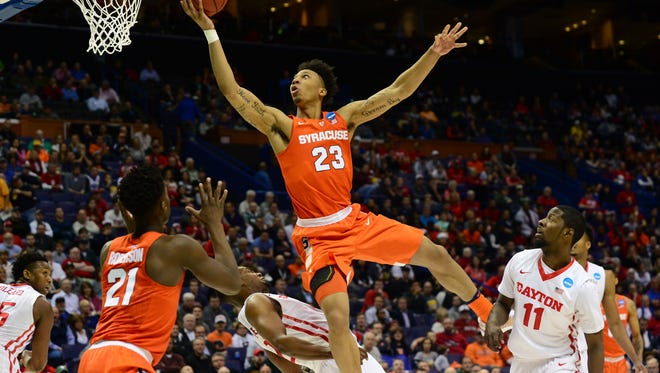 Syracuse guard Malachi Richardson goes up for a shot over Dayton Flyers forward Dyshawn Pierre (21) during the second half on Friday afternoon Richardson led Syracuse with 21 points.