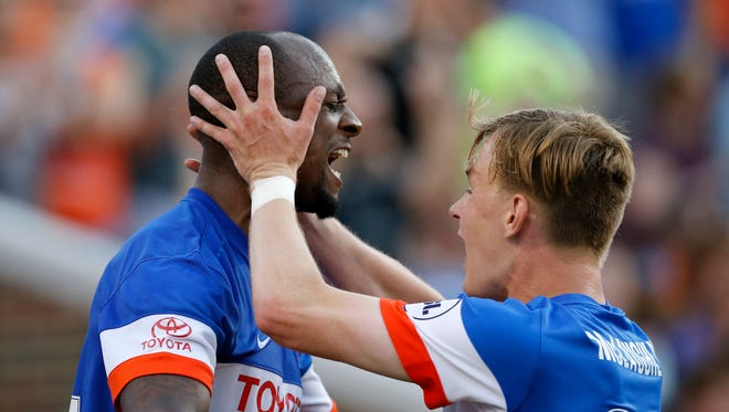 FC Cincinnati Justin Hoyte (32) celebrates with Jimmy McLaughlin (20) after scoring the tying goal in the first half of the USL Soccer match between FC Cincinnati and Charlotte Independence at Nippert Stadium on June 10, 2017