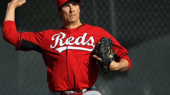 Reds starting pitcher Homer Bailey throws during a bullpen session at spring training in Goodyear, Arizona. Bailey is returning this season after undergoing surgery late last season. The Enquirer/Kareem Elgazzar