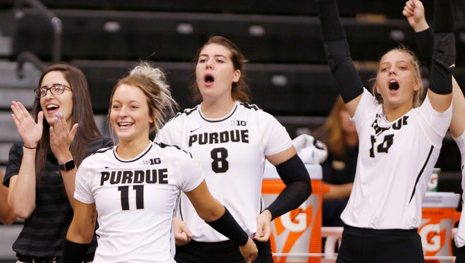 Carissa Damler (11) and her teammates on the bench react to a Purdue point against Oral Roberts in the third set Friday, August 25, 2017, at Holloway Gymnasium on the campus of Purdue University. Purdue defeated Oral Roberts 25-15, 25-13, 25-20.