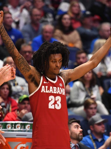 Mar 14, 2019; Nashville, TN, USA; Alabama Crimson Tide guard John Petty (23) celebrates from the bench after a three-pointer against the Mississippi Rebels during the second half of the SEC conference tournament at Bridgestone Arena. Mandatory Credit: Christopher Hanewinckel-USA TODAY Sports